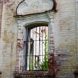 Window in the destroyed old house - Stock Photo
