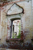 Window in the destroyed old house — Stock Photo
