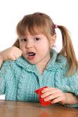 The little girl eats yoghurt — Stock Photo