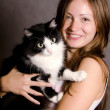 The beautiful girl with a cat - Stock Photo