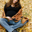 The pregnant girl in autumn park — Stock Photo #7433805