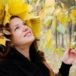 The beautiful girl in autumn park — Stock Photo