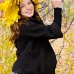 The pregnant girl in autumn park — Stock Photo