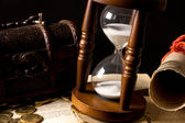 Hourglasses and book On black — Stock Photo