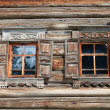 Window in the old wooden house - Stock Photo
