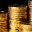 Stock Photo: Golden coins isolated on black background