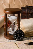Hourglass and the book - vintage — Stock Photo
