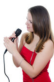 Girl with a microphone isolated on white — Stock Photo