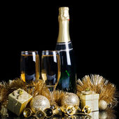 Champagne with Christmas ornaments — Stock Photo