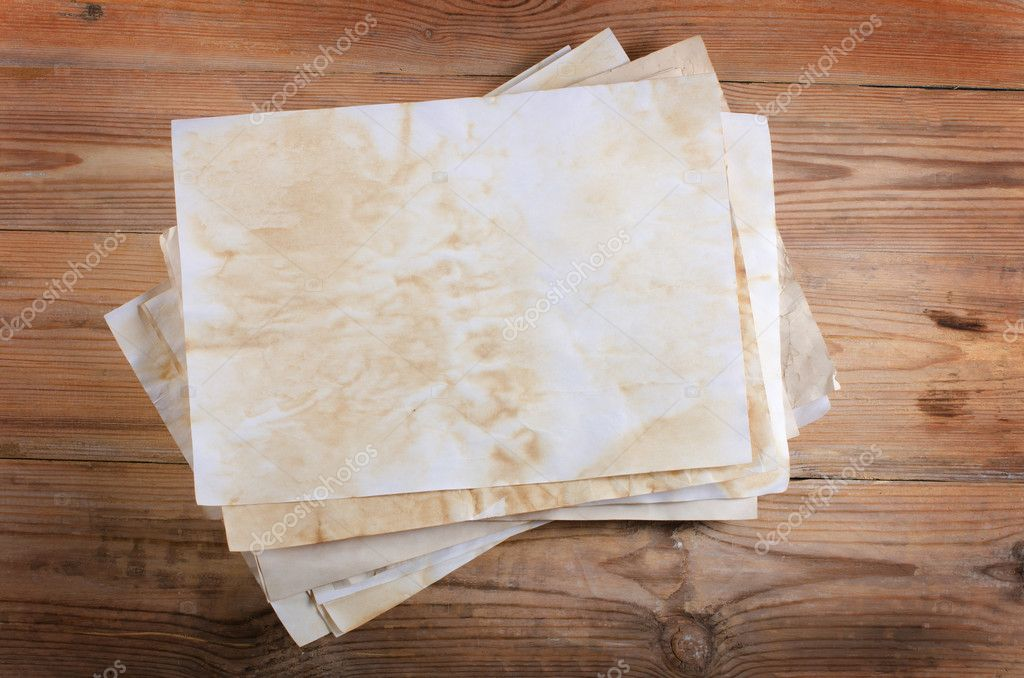 The old paper on a wooden surface — Stock Photo #7713742