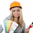 The beautiful girl in a building helmet — Stock Photo