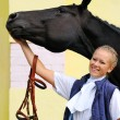 Girl and black sportive horse before competitions — Stock Photo