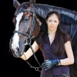 Young girl with black sport horse — Stock Photo