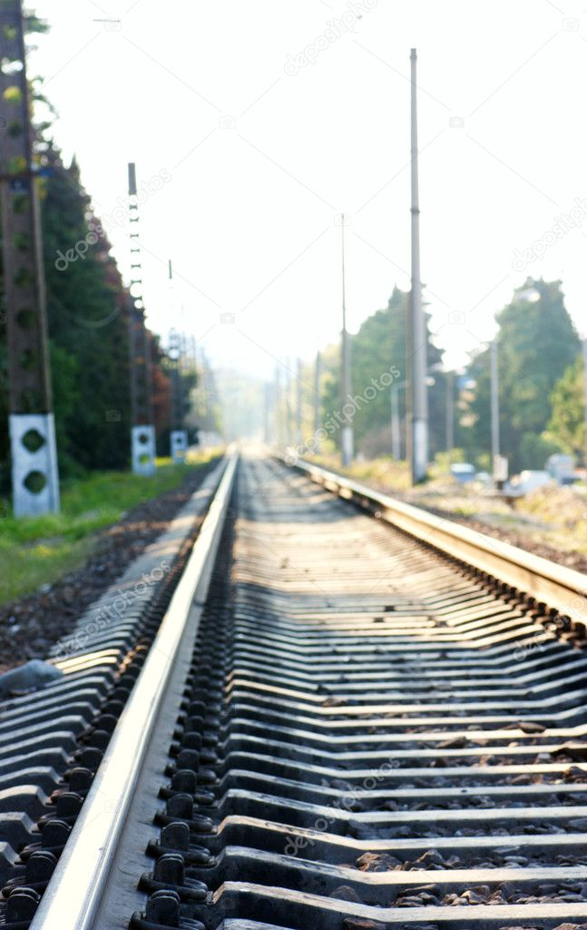 Railway recedes into the distance in a sunny day — Stock Photo #7467280