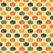 Halloween seamless background with pumpkin. Retro pattern. — Vector de stock  #7300751