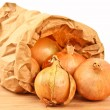 Fresh onion in a brown paperbag — Stock Photo