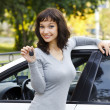 Pretty girl showing the car key — Stock Photo