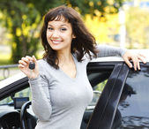 Pretty girl showing the car key — Stok fotoğraf