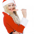 Santa girl with lollypop — Stock Photo