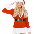 Pretty Santa girl saluts you! - Stock Photo