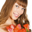 Pretty girl with tulips — Stock Photo