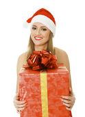 Santa girl with a present — Stock Photo