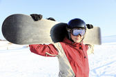 Female snowboarder on the snowhill. — Stock Photo