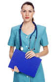Bardzo kobiece kobieta lekarz lub pielęgniarka — Zdjęcie stockowe