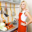 Pretty woman  at the kitchen — Stock Photo