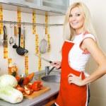 Pretty woman at the kitchen — Stock Photo