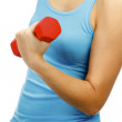 Woman with dumb-bells in hands — Stock Photo
