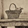 Wicker basket on a bench — Stock Photo