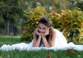 Happy bride in park 2 — Stock Photo