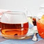 Black tea and apple jam — Stock Photo