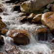 Water flow (stream) among the stones — Stock Photo