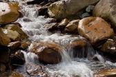 Water flow (stream) among the stones — Foto de Stock