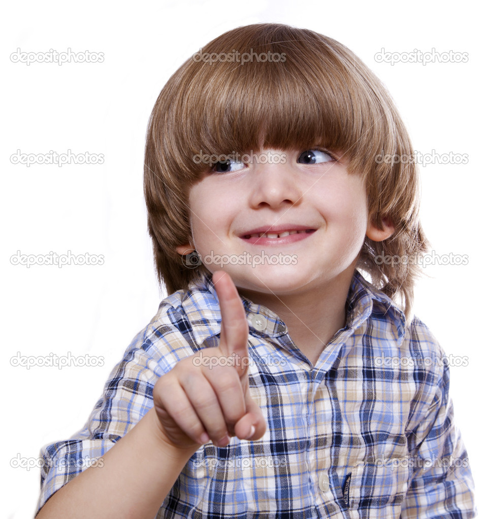 Cheerful boy shows his finger and smiling on a white background — Stock Photo #7066936