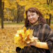 Portrait of woman in autumn leaves — Stock Photo