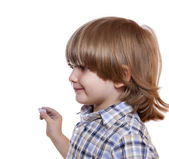 Cute little boy with chalk in hand — Stock Photo