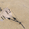 Wall Clock in the sand — Stok fotoğraf
