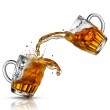 Beer splash in glasses isolated on white — Stock Photo