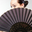 Closeup portrait of flamenco dancer with fan — Stock Photo #6975541