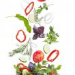 Falling vegetables for salad isolated on white — Zdjęcie stockowe #6994745