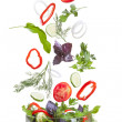 Стоковое фото: Falling vegetables for salad isolated on white