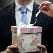 Closeup portrait of businessman holding gift with womans hand - Foto de Stock
