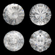 Stock Photo: Top views of large diamonds on black