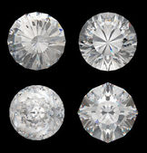 Top views of large diamonds on black — Stock Photo