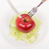 Apple on a plate — Stock Photo