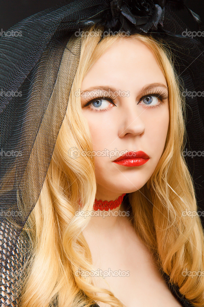 Sad blue eyes attractive blonde in a black veil — Stock Photo #7588552