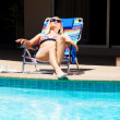 The wooman on the pool area — Stock Photo